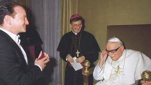 Bono sharing his signature sunglasses with St. John Paul II